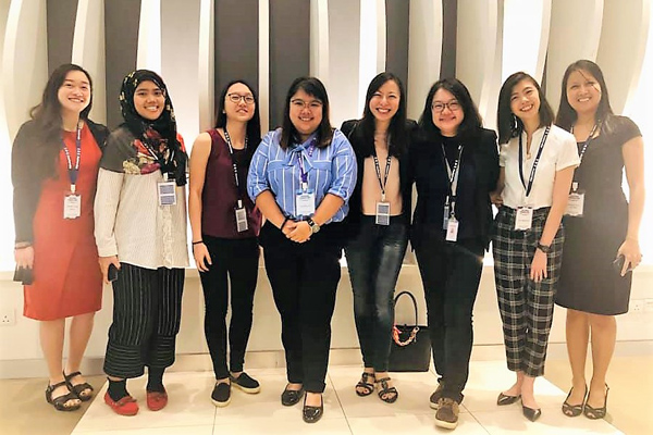 Department of Psychology lecturers, Ms Woo Pei Jun and Dr Wo Su Woan (4th and 3rd from right, respectively) with graduates from the BSc (Hons) Psychology Programme who are now working in the field of applied behaviour analysis for special needs children.